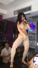 Scantily clad sexpot sings on the bar