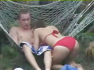 Blowjob in a hammock from a voluptuous bikini girl