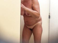 Fat grandma takes a long shower