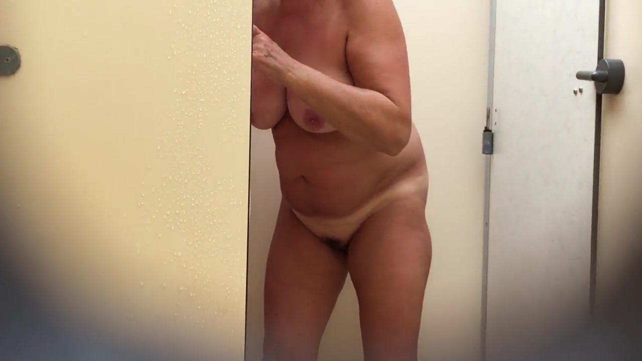 Fat grandma takes a long shower