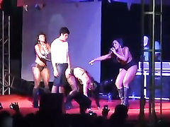 Athletic strippers demonstrate their skills for an audience