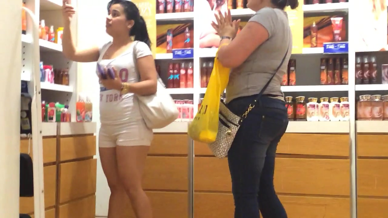 Shopping with a big butt woman in tight shorts