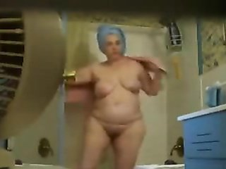 Fat neighbor dries herself with a towel