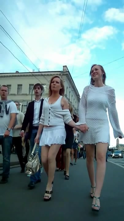 Short white skirts on beauties walking the city