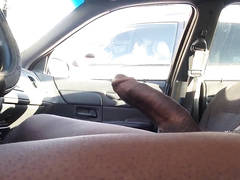 Nude black dude in a car jerks off
