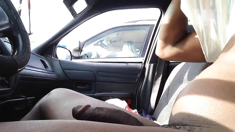 Charming blonde sees his large black dick exposed in the car