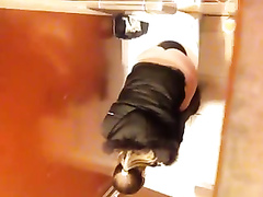 Spying on a nice ass goddess peeing in the toilet