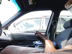 Jacking his black cock in a parked car