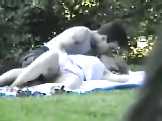 Fingering his cute blonde girlfriend in the park