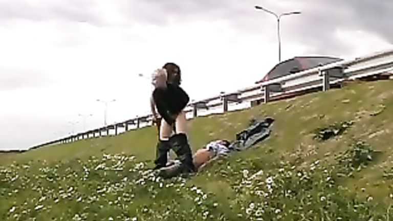 Girls beat up a guy and ride him by the highway