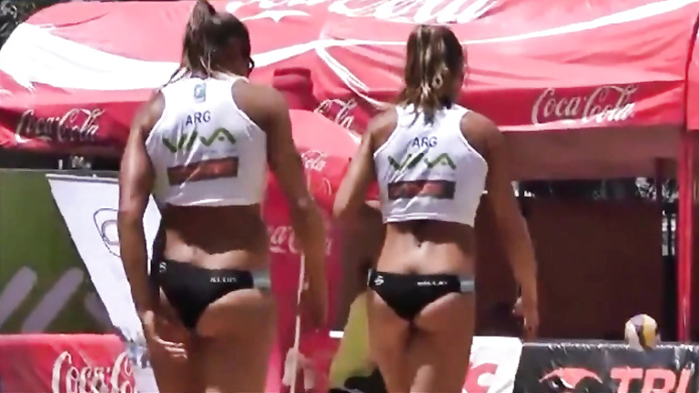 Beach volleyball girls with athletic asses in bikini bottoms