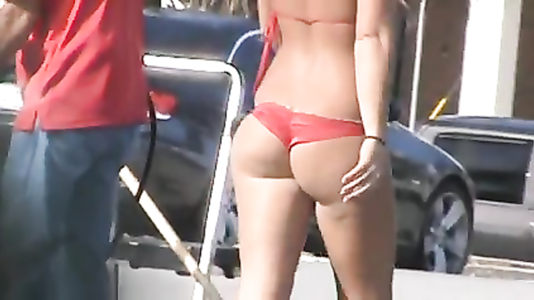 Fine ass chick in a red bikini washes cars