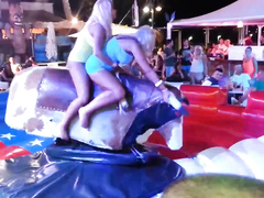 Bimbos in panties ride the mechanical bull together