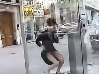 Sexy lady flashes her pussy in a phone booth