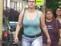 Big bouncy boobs on a British woman walking the street