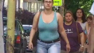 Big bouncy boobs on a British woman walking the street