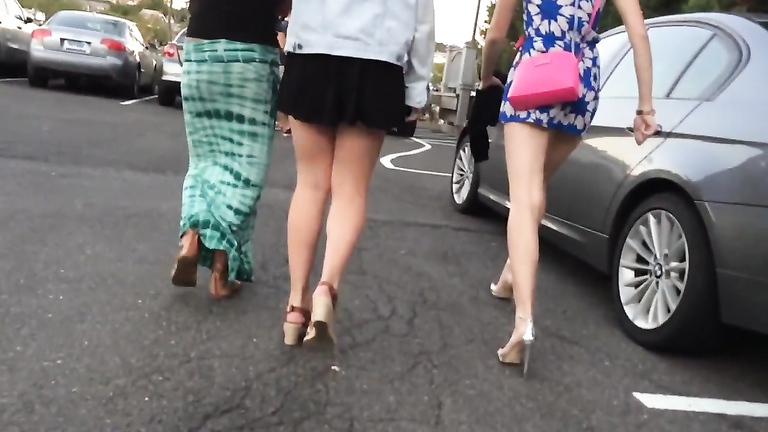 Slow motion walk with beauties in short skirts