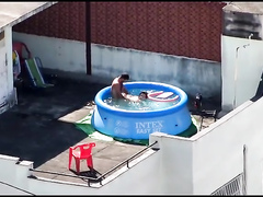Doggystyle screwing outdoors in the pool