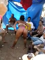 Lap dancing bikini babe at an outdoor party