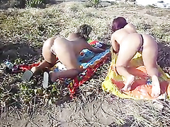 Pussy and ass flashing girls in the grass