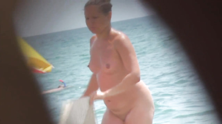 Ukrainian cougar on the nudist beach