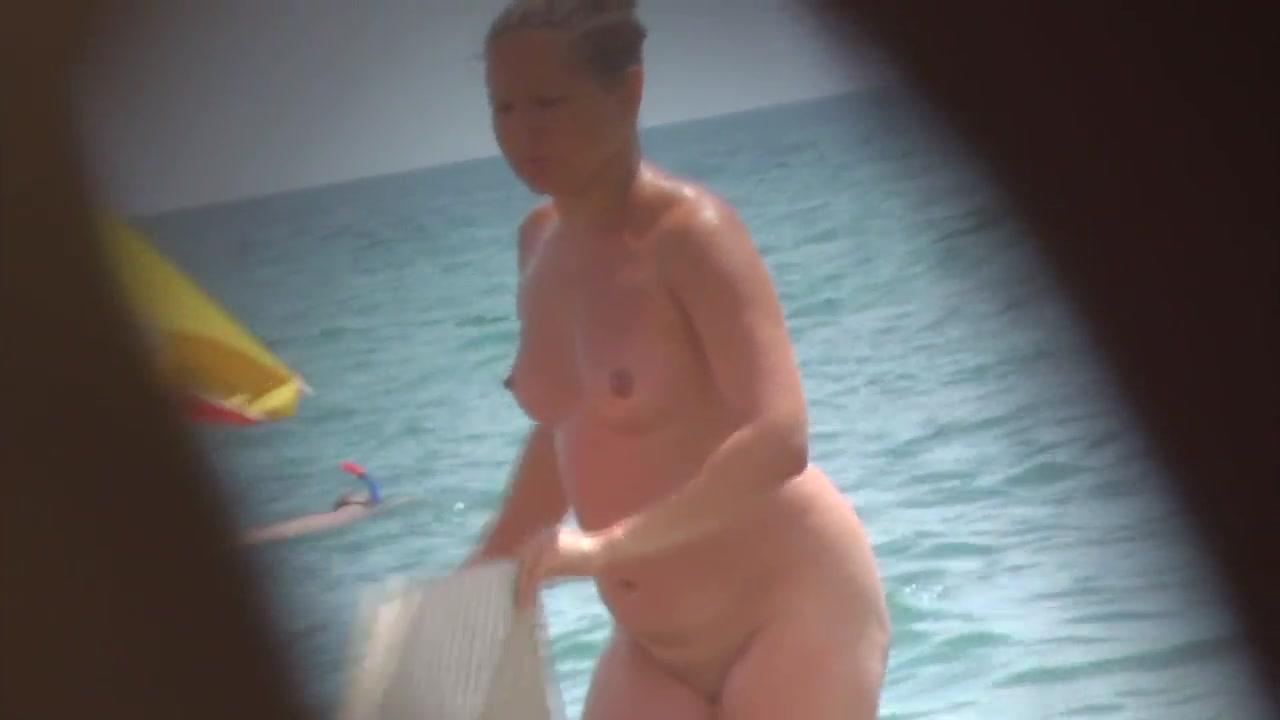 Ukrainian cougar on the nudist beach