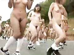 Huge group of naked Japanese girls stretches outdoors