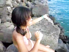 Indian girl in a sexy bikini at the ocean