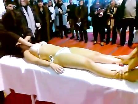 Double massage in public of an Asian bikini girl