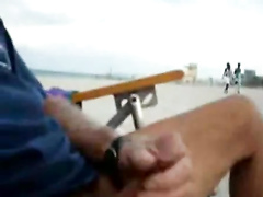 Stroking my dick on the public beach