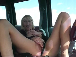 Great breasts on a milf masturbating in the car