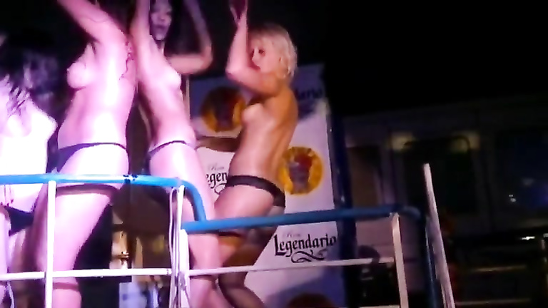 Club dolls dancing topless for the crowd