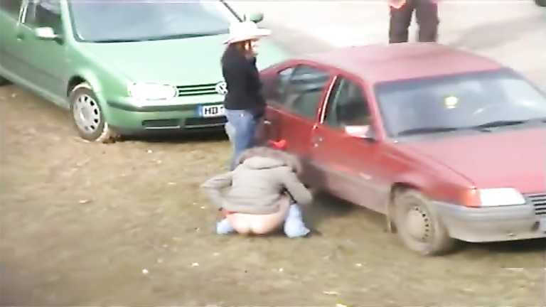 Cutie squats and pisses behind a car