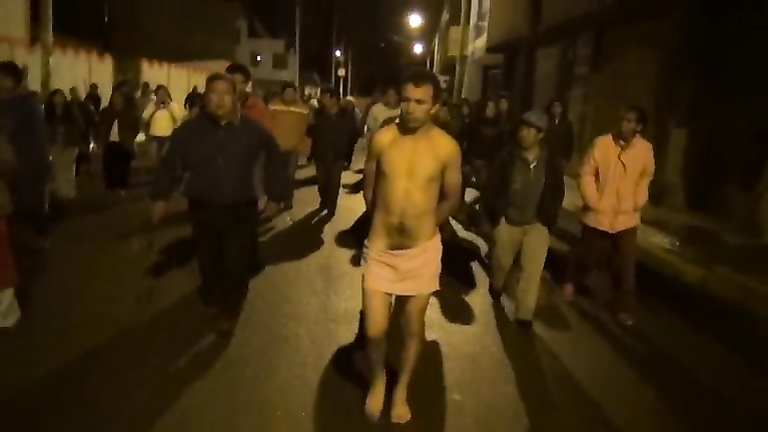 Cops walk a nearly naked criminal down the street