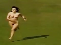 Naked woman streaks across the pitch