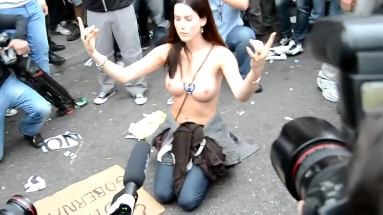 Topless goddess with great tits on a busy street