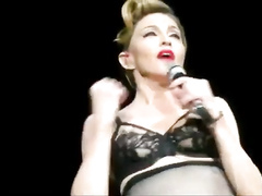 Madonna in lingerie on stage at a show