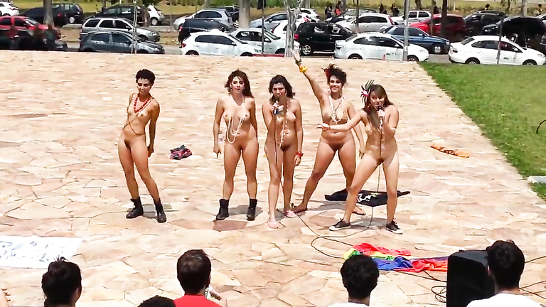 Naked singing and dancing girls put on a public show