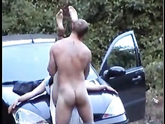 Couple has sex on the hood of a car