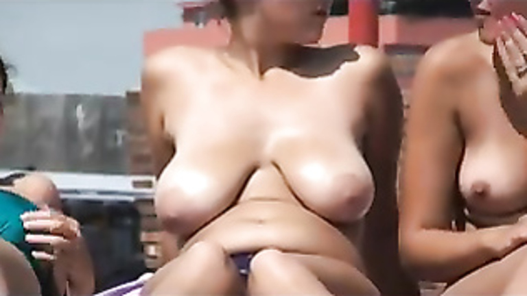 Chubby nerd smears her tits with sun cream
