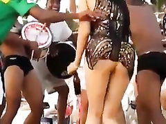 Hot Latina chicks dancing at a beach party