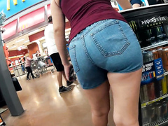 Tight denim shorts cling to her nice ass