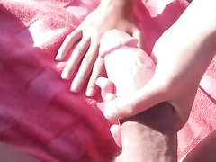 Big dick handjob at the beach from my GF