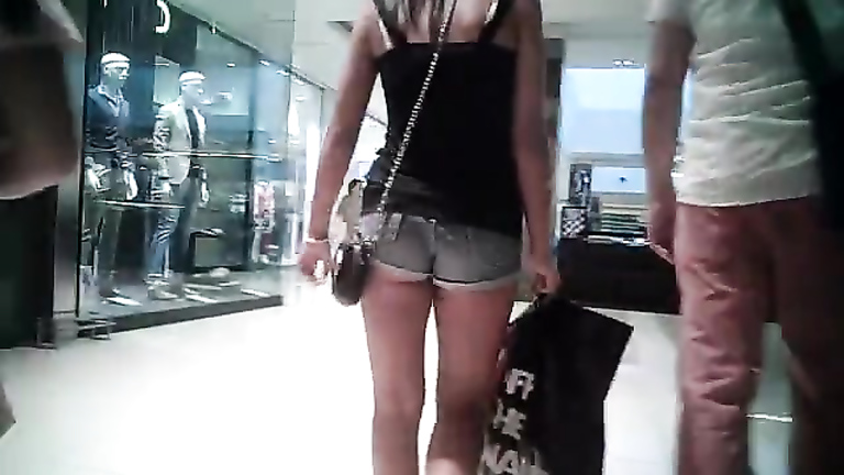 Short shorts on a hot ass at the mall