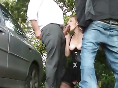 Dogging milf beauty makes two guys cum