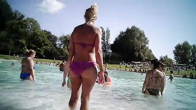 Mature asses in bikinis at the pool