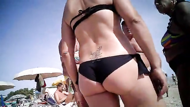 Milf with a tramp stamp at the beach