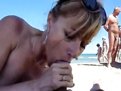 Dick and ball sucking wife at a public beach