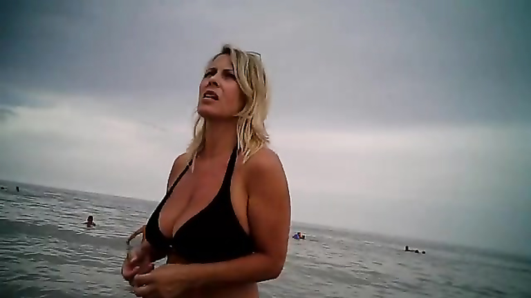 Gorgeous blonde female video taped at the public beach