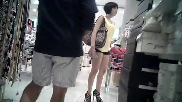 Milf hottie in heels and booty shorts at the store